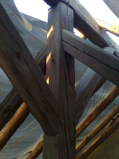 single metal nail. Despite their age, all the massive timbers are in excellent condition and the new roof was laid over them.