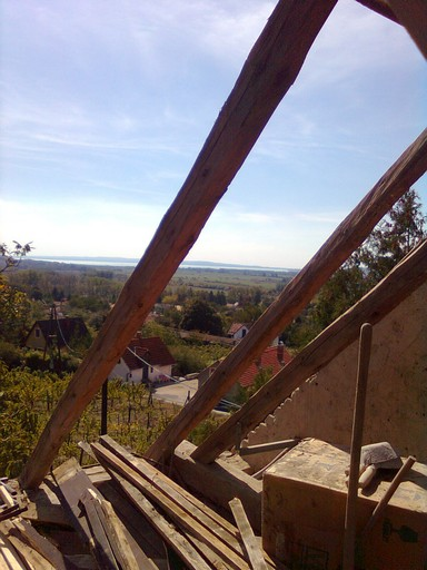 View of Lake Balaton through the roof rafters after tiles were removed.