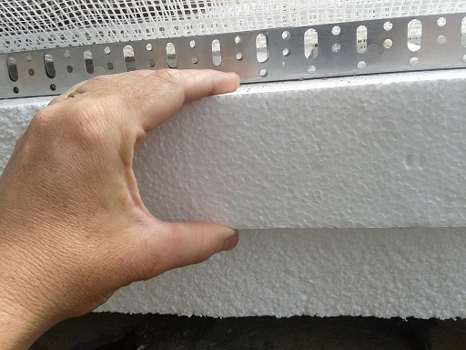 Because of the bricks that made up our wall, we decided to go with an 8 cm (3.15 inch) thick insulation layer.