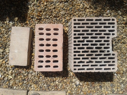 From left to right: normal red brick, old insulating brick, and modern insulating brick.