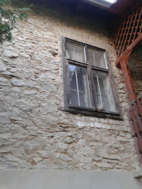 The old window still in the wall after external plaster was removed.