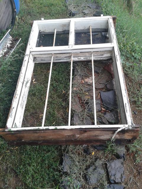 The old window after removal. I have to admit, I will not miss the prison bar look.
