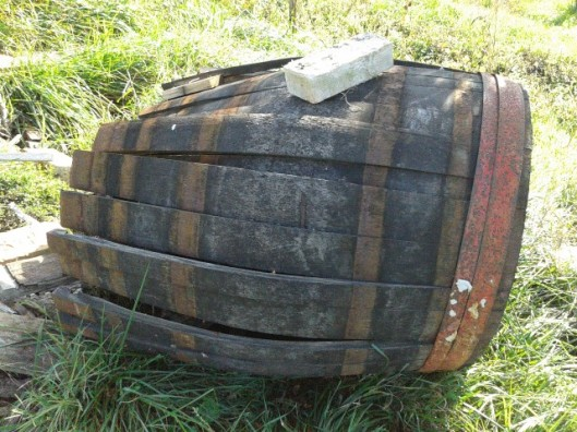 Oak barrel being broken up for firewood.