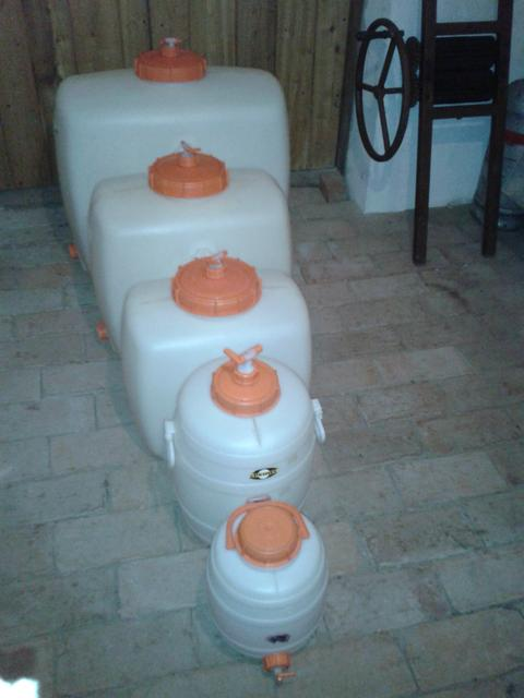 HDPE plastic barrels in various sizes. Front to back: 200 l, 100 l, 60 l, 30 l, 12 l.