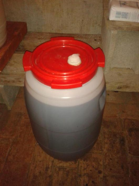 60 liter vat with lid and cotton plug in place for primary fermentation.