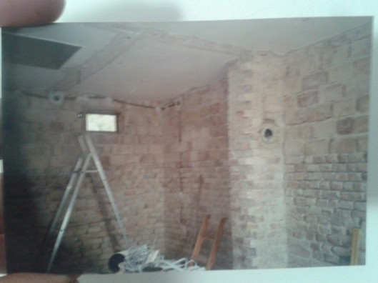 Old printed photo showing early work on our house renovation.