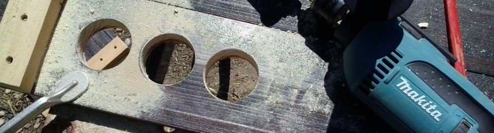 To let air flow through the dehydrator, I used a large key hole drill bit to make a series of spaced holes at the base and top of each end wall of the dehydrator.