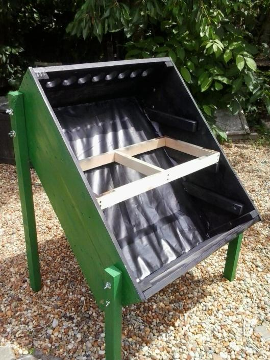 To protect the box and contents from the rain, I painted the dehydrator with some left over green paint on the outside and black paint on the inside. The dehydrator legs, trays and tray supports were constructed as per the plans, from the above link, with leftover 5cm x 5cm wood for the legs, 3cm x 5cm wood for the try supports and 2cm x 5cm wood for the trays. This photo shows a newly built tray being test fitted before it is also painted black. The only thing I bought was screen for the trays (I had some already, but not very much and what I did have was used to cover the round end holes at each end of the dehydrator box).